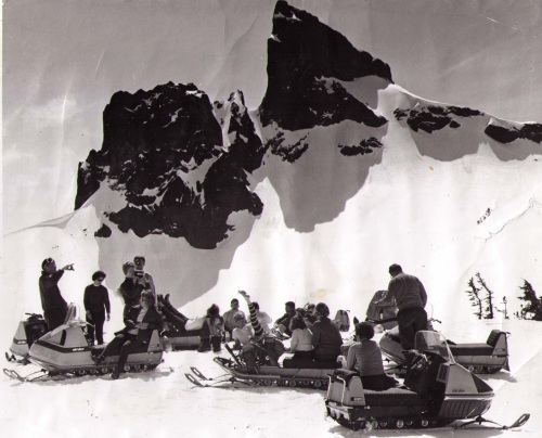 Unfortunately, we don't have any background info of this archival photo of snowmobilers taking a break in front of Black Tusk. Judging by the sleds, this is probably from the early 1970s.