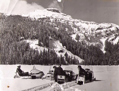 From R-L, Dick Fairhurst, Gray Mitchell, Stephan Ples, and Don Gow take a break on Callaghan Lake, March 1970. The entire upper Callaghan Velley, including Callaghan Lake, is now a non-motorized zone to avoid conflicts with backcountry and nordic skiers.