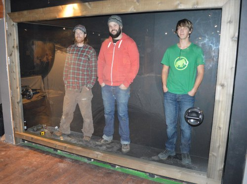 Our new display case! Curious as they look, these humans won't be on display once we re-open to the public.