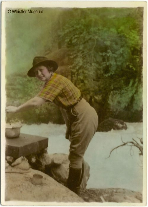 Myrtle cooking beside a river, ca. 1935. Philip Collection.