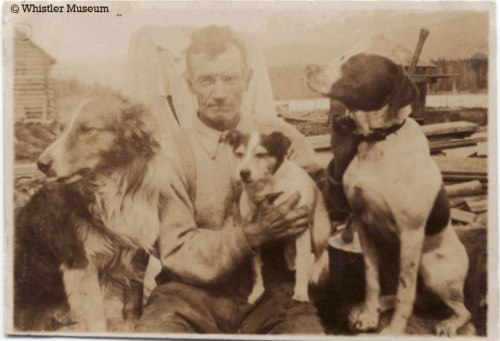 Sewall Tapley and dogs, 1918. Philip Collection.