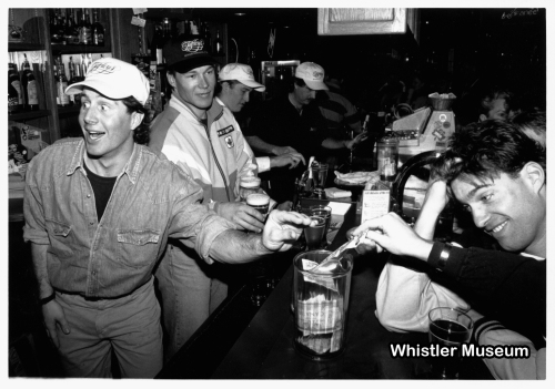 WORLD CUP WEEK '93 - National Team members Luke Sauder, Ralf Socher, Cary Mullen and others pour beer at Tapley's