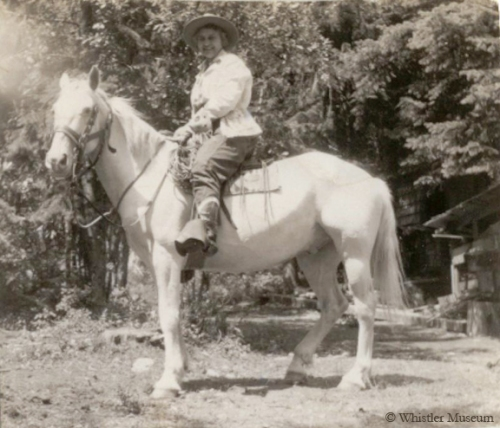 Myrtle on a white horse, ca. 1940. Philip Collection.
