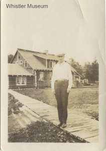 Alex Philip on the boardwalk in front of Rainbow Lodge, ca. 1920. Philip Collection.