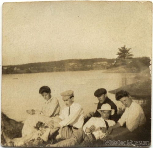 """Alex Philip and friends in Maine. The annotation on the reverse reads """"Alex Philip in his 20s, Bluehill Maine, 2nd from left, about 1906."""" Philip Collection."""