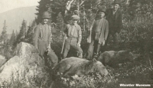 Hunters with two trophy grizzly bears in the Singing Pass/Musical Bumps area, ca. 1916.