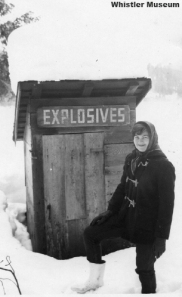 Jean McDevitt in front of Petersen's old outhouse, 1968.