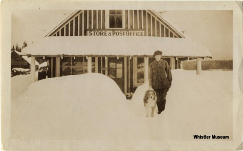 Myrtle Philip and her dog standing outside the post office, ca. 1930. Philip Collection.