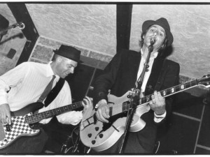 "Brothers Peter and Stephen Vogler playing at Whistler's famous Boot Pub in the late 90s. Photo: Chris Woodall, published in Stephen Vogler's book ""Only in Whistler. Tales of a Mountain Town"""