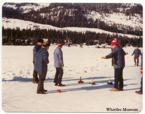 Group of people playing ice stock sliding (Eisstockschiessen, the European version of curling) on Alta Lake, 1970s. Whistler Museum, Philip collection