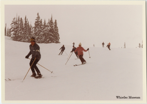"""Ski conditions were excellent during their stay with snow falling all three days."" proudly reported Garibaldi's Whistler News in their spring issue of 1971. The photo shows Area Manager Jack Bright, flowed by Margaret Trudeau and the Prime Minister ski down the Red Chair run. March 1971, Whistler Mountain collection"