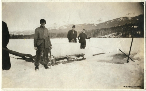 Cutting ice was a big event at Alta Lake. The Photograph shows Sewall Tapley (Myrtle Philip's father) in foreground and Rainbow Lodge guests. Whistler Museum, Philip collection, 1920s