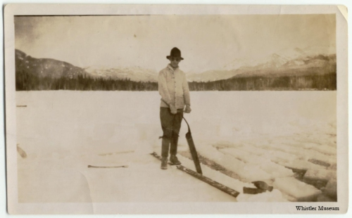 A chore for every winter until Hydro came in: Alex Philip with an ice saw cutting blocks of ice out of Alta Lake. They were stored in sawdust in an ice house for summer use. Whistler Museum, Philip collection, 1920s
