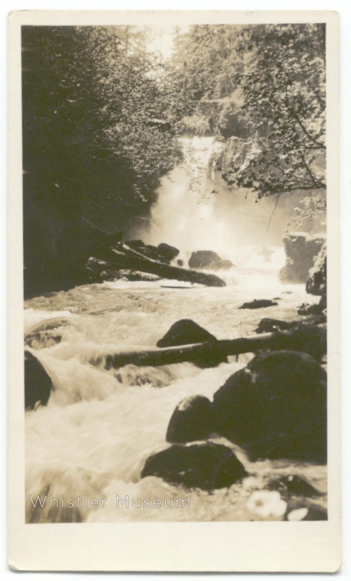 """On the reverse is written a note, presumably to Myrtle of Alex Philip. It reads """"This could be made a nice picnic spot for hikers or riders from Rainbow as it is a beautiful waterfall and to make a pony trail would mean very little work from Pemberton trail below mile 43 post. Wedgemount Creek Falls."""