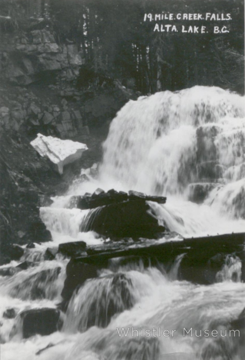 "Photograph appears to be a copy of an original postcard. On the front is written ""19 Mile Creek Falls, Alta Lake, B.C."" On the reverse is written the following: ' ""Above Alpine Meadow - that's where they get their water supply"". (MP '83) ""This was taken when we just began going up there about 1924. MP ('83)'"