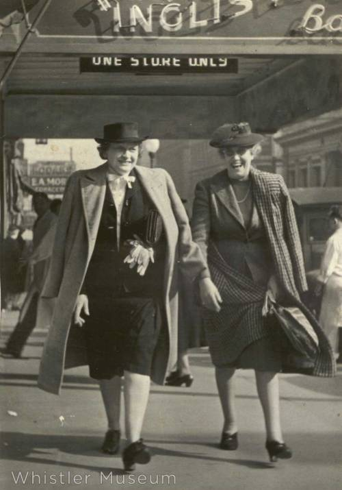 Myrtle Philip and Grace Naismith in street clothes in a sidewalk in Vancouver. Photographer's stamp on verso :