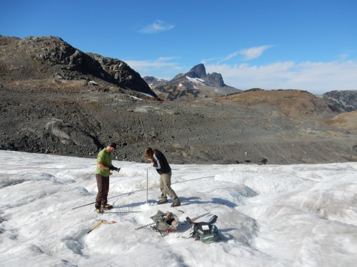 Hand-drilling five metres down into the glacier is low-tech hard work, but these gus weren't complaining. Jeff Slack photo.