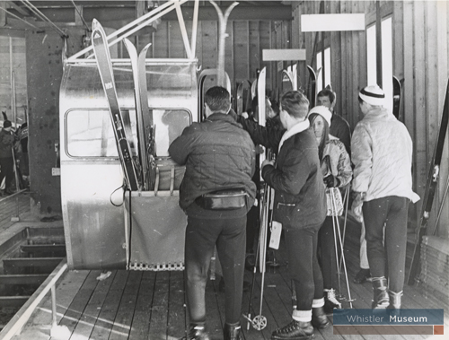 Skiers load the original four-person gondola at the base of Whistler Mountain in the late 1960s.
