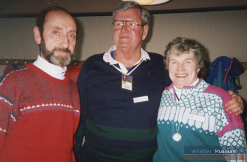 Denis and Pat Beauregard, who ran movie nights as ALCC volunteers, receiving silver coins for Whistler Mountain's 25th Anniversary from Maurice Young (centre).