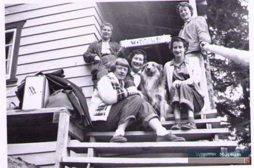 "Florence Petersen (founder of the Whistler Museum & Archives Society) and her friends (left to right) Jacquie Pope, June Tidball, Fido, Getty Gray and Eunice ""Kelly"" Forster at their Witsend cottage in 1955."